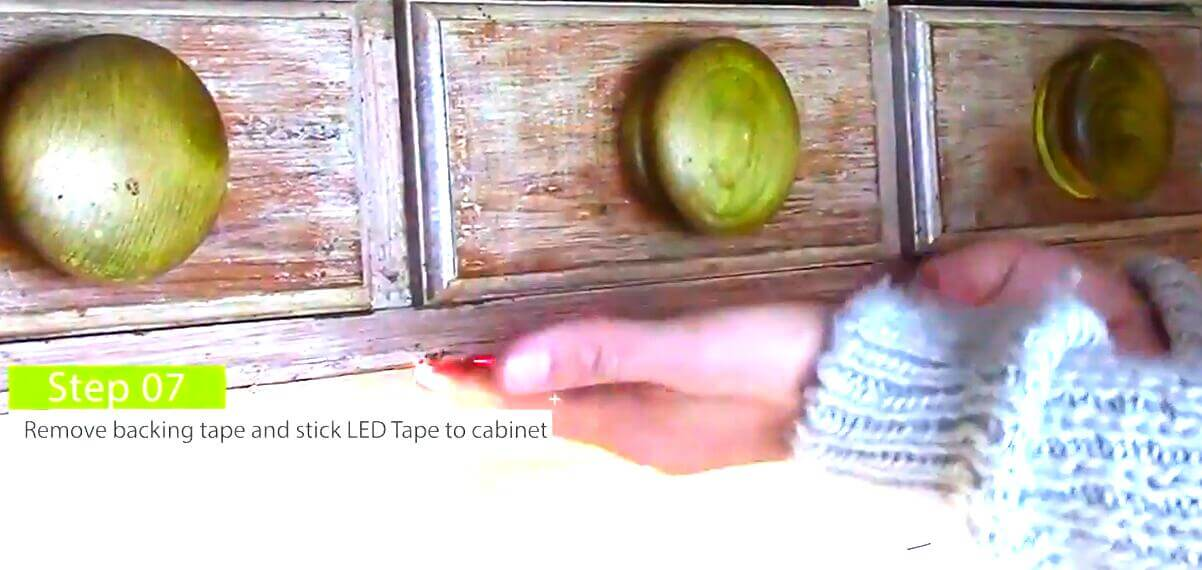 Remove backing tape and stick led tape under the cabinet